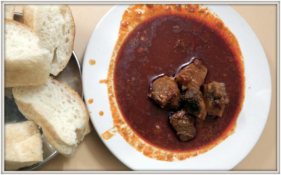 Pork Vindaloo – served with rice/pav