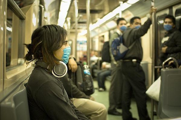 153771-Swine_Flu_Masked_Train_Passengers_in_Mexico_City