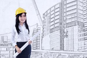 Beautiful young female architect holding blueprint on construction drawing background